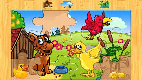 德国农场动物拼图的孩子